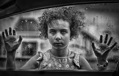 """I thought how unpleasant it is to be locked out; and I thought how it is worse, perhaps, to be locked in.""— Virginia Woolf (Lorrainemorris) Tags: lorrainemorris zeissbatis85 framed glass cardoor feeling hunting mood raindrops rain portrait child batis sony7rm2 sony blackandwhite mono lockedin lockedout car"