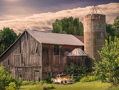 A Little More   _ (henryhintermeister) Tags: barns wisconsin oldbarns clouds farming countryliving country sunsets storms sunrises pastures nostalgia skies outdoors seasons field hay silos dairybarns building architecture outdoor winter serene grass landscape plant cloudsstormssunsetssunrises bloomerwi
