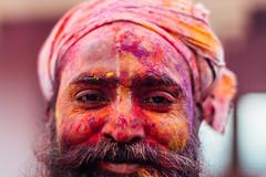 Colorful Man's Face, Holi in Vrindavan India (AdamCohn) Tags: adamcohn india vrindavan celebration colorful colors face gulal holi mustache portrait smile wwwadamcohncom