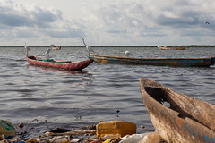 Down on the River, Ziguinchor (Geraint Rowland Photography) Tags: environment river waterways pollution garbage rubbish sas surfersagainstsewage dump downontheriver ziguinchor canon africa westafrica birds egrets canoes woodenboats handcarvedboats depthoffield geraintrowland wwwgeraintrowlandcouk africanlandscapes