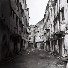 (Ifitis) Tags: buildings backstreet blackandwhite fuji acros100 kualalumpur pentaconsixtl biometar80mmf28 malaysia unevendevelopment d76 10 self diy jalanhorley