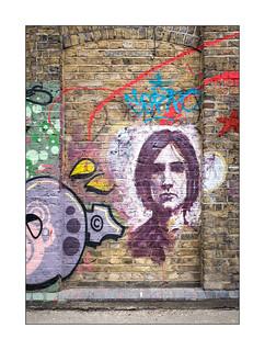 Street Art (Pang), East London, England.