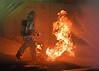 Damage Controlman 3rd Class Chris McNeil walks into a simulated fire. (Official U.S. Navy Imagery) Tags: blueridge navy sailor male photo flagship fire dvidsemailimport yokosuka japan