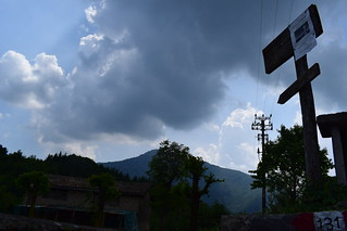 many things under a cloudy mountain sky