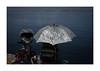 protection (giovdim) Tags: street greece people fishing umbrella sun seafront