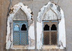 Wooden carved windows of an abandoned house, Dhofar Governorate, Mirbat, Oman (Eric Lafforgue) Tags: abandoned arabia arabianpeninsula arabic arabicarchitecture arabicstyle architecture buildingexterior carved carvedwindow carvingcraftproduct colorimage day decrepit dhofar dhufar exteriorview facade ghosttown gulfcountries habitation history horizontal house houseexterior mirbat moscha nopeople old oldhouse oman oman18191 outdoors sultanate thepast traveldestination traveldestinations weathered window woodenwindow dhofargovernorate om