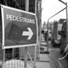 Pedestrians (Gabo Barreto) Tags: leeds fence sign contructionsite wiredfence arrow film 6x6 120 mediumformat tmx kodak kiev88cm commiecamera russiancamera selfdeveloped scannedfromfilm blackandwhite monochrome filmisnotdead ishootfilm analoguephotography slr xtol