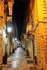 Malta Streets (Douguerreotype) Tags: lights city dark night balcony buildings malta architecture valletta sign door urban