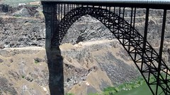 Base Jumping from Perrine Bridge in Twin Falls, Idaho (lhboudreau) Tags: bridge river snakeriver idaho twinfalls perrine perrinebridge canyon outdoor outdoors road snakerivercanyon ushighway93 route93 highway93 truss arch trussarch water cliff cliffs rock video videos rocky jump jumping jumper jumpers basejumping basejumper basejumpers parachute parasail sport extremesport