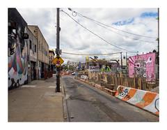 160515_1405_160515 105318_oly_S1_New York (A Is To B As B Is To C) Tags: aistobasbistoc usa newyorkstate newyork roadtrip travel olympus stylus1s brooklyn bushwick stnicholasave troutmanst street sidewalk sign signs wire cables work yard graffiti tags tag construction site streetart pole car city edge urban urbanrenewal gentrification