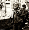 Old Men and Grainy Film. (Neil. Moralee) Tags: neilmoralee man old mature sepia toned grainy film camera photographer candid bristol uk walk walking beard glasses black white bw bandw blackandwhite iso noise noisy gritty raw street neil moralee olympus omd em5 mono monochrome silver fx2