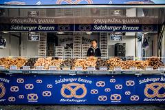 Difficult to choose (Melissa Maples) Tags: salzburg österreich austria europe nikon d3300 ニコン 尼康 nikkor afs 18200mm f3556g 18200mmf3556g vr winter residenzplatz pretzels vendor snacks food reisinger salzbergerbrezen