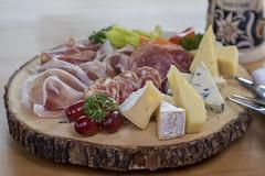 Appetizer platter (DocAdvert) Tags: appetizer platter wooedenplate docadvert ollikramp ham sausage cheese grapes beermug fork bluecheese