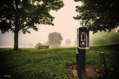 Just in case. (Igor Danilov Philadelphia) Tags: fog foggy park morning phone stand mist trees field grass green spring bench empty lake tree forgotten lost unused unwonted shadow vignetting veil nature hiding disguise hide hidden outofplace nikondslrd700 nikon2470mmf28