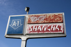 A-1 Shanghai (Curtis Gregory Perry) Tags: centralia washington sign shanghai a1 car dealership butterfly chinese restaurant sky blue red old plastic nikon d810 highway 507