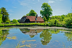 Mill Pond (Geoff Henson) Tags: pond water reflection tree house mill sky blue green