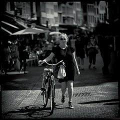 Lady with Bike (Fouquier ॐ) Tags: hipstamatic scottslens blackeysirfilm mono monochrome bw blackandwhite urban city street streetphotography bicycle girl blonde antwerp belgium