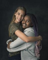 BFFs (mckenziemedia) Tags: bff bestfriends love friends portrait portraiture girls backdrop soft light hug embrace unity family girl relationship