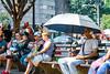 Intentionally Oblivious (Geoff Livingston) Tags: hbm bench monday street umbrella scene