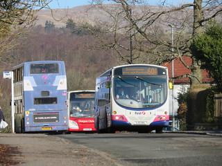 First Glasgow 61663 SJ51DKL passses 33386 LK53EZF with Glasgow Citybus YX61EMF
