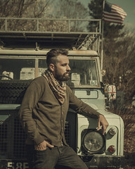 In Frankford. (pedferr) Tags: portrait flag cinematic fashion moody 4x5 jeep sweater male beards outdoors model antique usa warm mensfashion old delaware unitedstatesofamerica sunny vintage scarf vehicle style cold bluesky editorial man sky classic selfportrait travel profile truck green steel lifestyle car dramatic