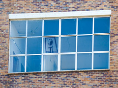 A for Abandoned (Steve Taylor (Photography)) Tags: eye graffiti streetart tag window brown blue white brick glass newzealand nz southisland canterbury christchurch cbd city shape cartoon pane crack