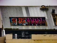 Mr Sad Face (Steve Taylor (Photography)) Tags: neuro killsimon rude ac vent graffiti streetart roof newzealand nz southisland canterbury christchurch city cbd corrugated