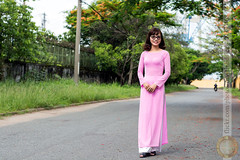 Teacher in a primary shool (Hosting and Web Development) Tags: stand costume one outdoor portrait person smile shoulder street summer young hair hand happy horizontal arm asia aodai body tree grass glasses walking road landscape vietnam flamboyant mohur delonixregia royalpoinciana fabaceae outside nikkor