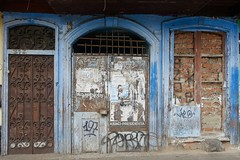 No entry, Callao (Yekkes) Tags: latinamerica southamerica peru lima callao decay abandoned sadness blue arch door entry portal blocked noentry urban street flyposting grills bricks