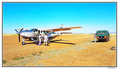 small chat after flying ... (harrypwt) Tags: harrypwt plane africa stripe airport transportation framed kenya safari savanah airplane