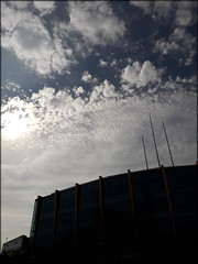Arena Birmingham in shadow, Birmingham city centre (Wagsy Wheeler) Tags: birmingham birminghamcitycentre citycentre brindleyplace sky clouds birminghamarena arenabirmingham nationalindoorarena nia barclaycardarena arena shadow spires silhouette canal sun landmark