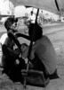 img282 (Höyry Tulivuori) Tags: india 1970 street life people cars monochrome men women child 70s vintage seventies temple city country индия улица чернобелое автомобиль дома народ быт barbershop