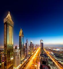 Gold and blue in Dubai (Siebring Photo Art) Tags: dubai dubaiskyline emirates level43dubai level43skylounge sheikhzayedroad uae blue gold lighttrails rooftop skyline skyscapers sunset traffic verenigdearabischeemiraten ae