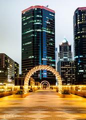 Illuminated Arches And Office Blocks Around Kowloon Harbour (Peter Greenway) Tags: skyscrapers hongkong nightlights urban kowloon night flickr nightphotography hk skyline offices officeblocks nighttime