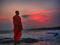 Orange Ji. (Prabhu B Doss) Tags: prabhubdoss travelphotography fujifilm gfx50s kanyakumari tamilnadu india incredibleindia indian ocean arabian sea monk swami swamiji saffron robe sunset clouds waves