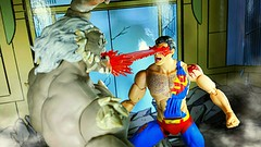 Even heat vision has little effect (custombase) Tags: dc icons figures deathofsuperman superman vs doomsday heatvision toyphotography