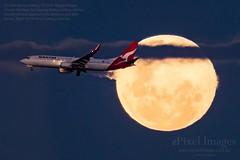 "Qantas Boeing 737-838 Reg. VH-XZN ""Wagga Wagga"" crosses the Near Full Waxing Gibbous Moon (ePixel Aerospace) Tags: vhxzn qantas boeing737838 boeing boeing737 waggawagga waxinggibbousmoon fullmoon moon aircraft finalapproach brisbane australia flight qf536"