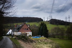 Power Pole Landscape (Christian Passi - Steher82) Tags: haus landschaft landscape nature outdoor germany deutschland strase strom power powerpole transmissiontower strommast strommasten clouds wolken photo photography fenster window architektur architecture garten gras tree trees sony sonya6000