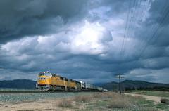 Storm light at Sandcut on the Union Pacific (Ray C. Lewis) Tags: union pacific railroad trains storm light clouds mojave sub tehachapi railroads mountain railroading sd70m ztrain