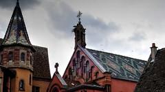 Rooftops - Tejados (Raúl Alejandro Rodríguez) Tags: techos roofs rooftops tejados iglesia church san leon ix cruces crosses nubes clouds place principale eguisheim alsacia alsace francia france cigüeña stork pájaros birds campana bell