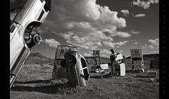 They Came Crashing to Earth Like So Many Broken Promises (Whitney Lake) Tags: blancoynegro blackandwhite bw desert cars junk sculpture art nevada goldfield theinternationalcarforestofthelastchurch