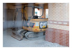 Caged Cat (Number Johnny 5) Tags: lines excavator d750 nikon digger cat space mundane caterpillar imanoot construction machinery johnpettigrew banal nifty 50mm angles nikkor yellow documenting fifty