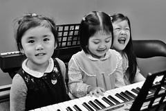 happy students (-liyen-) Tags: childrenstudents music class keyboard piano bw fujix100flaughter kids children students pupils musical fun joy challengeyouwinner