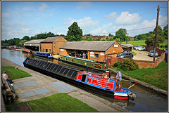 ABER (Jason 87030) Tags: narrowboat barge canal cut guc grandunioncanal man people watching scene nice village chandlers boats water uk england june 2018 grandunioncanalcarryingcolts middlewood isuzu buildings northants 101 northamptonshire sony ilce alpha a6000 shot shoot sunny light weather clouds sky towpath unitedkingdom waterways color colour