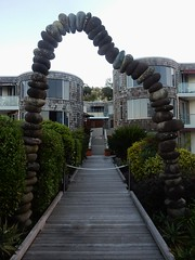 Defying Gravity (mikecogh) Tags: paihia gravity stones arch glue clever path decking boardwalk flats