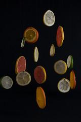 Suspensión Cítrica (fanycidad) Tags: fruit fruits lemon orange lime black contrast colorful composition abstract artistic