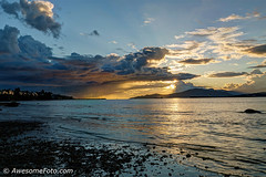 Raining vs Sunsetting (james c. (vancouver bc)) Tags: sunbeam sunray sun sailboat rock sky blue raining landscape dark mountainrange ship mountain white island cloudy golden cloud dramatic ocean sea inlet gray grey sunset canada beach volunteerpark park wave ripple vancouver britishcolumbia water seaside color colour cloudscape evening twilight dusk