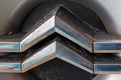Wheel embellisher (christina.marsh25) Tags: citroen c6 automatic transportation macromondays closeup macro wheelembellisher hubcap chevron