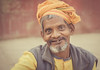 along the ghats (andy_8357) Tags: sony a6000 6000 ilcenex ilce6000 mirrorless portrait portraiture street natural light kind open face teeth warmhearted warm simple sigma 60mm f28 dn art dof shallow eyes friendly friendliness character man varanasi india indian goatee beard ganga ganges mother