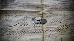 Une page d'histoire, signée Louis XIV. (Christophe.R) Tags: document parchemin signature pièce argent louis roi louisxiv plume encre vélin monnaie